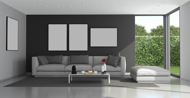 Zwarte en grijze moderne woonkamer met grote ramen en tuin op de achtergrond