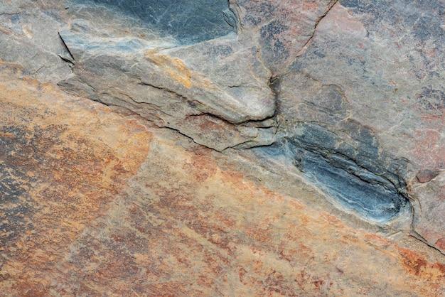 Zwarte en oranje steen bekledingstextuur bevat geschikte scheur- en steenlijnen