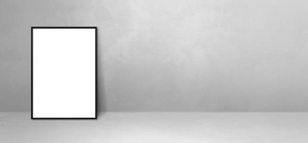 Zwarte fotolijst leunend op een lichtgrijze muur. lege mockup-sjabloon. horizontale banner