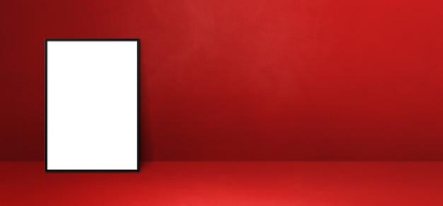 Zwarte fotolijst leunend op een rode muur. lege mockup-sjabloon. horizontale banner