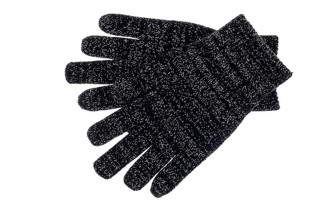 Zwarte gebreide babyhandschoenen die op wit worden geïsoleerd
