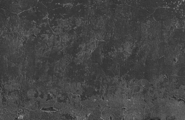 Zwarte gepleisterde muur met een lichte scheuren