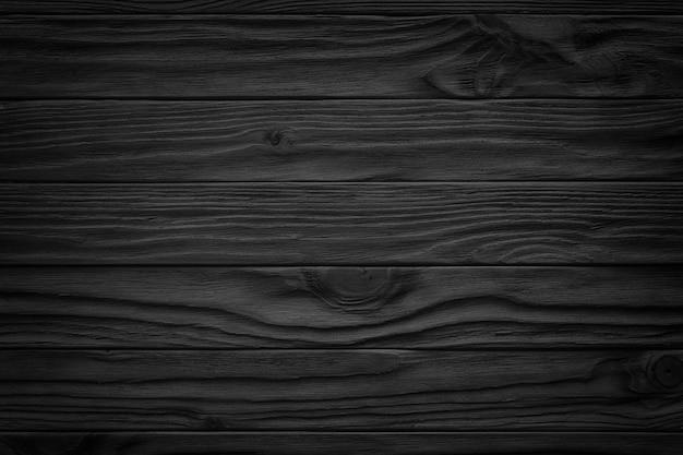 Zwarte houten abstracte achtergrond met licht en krassen, donkere houtstructuur