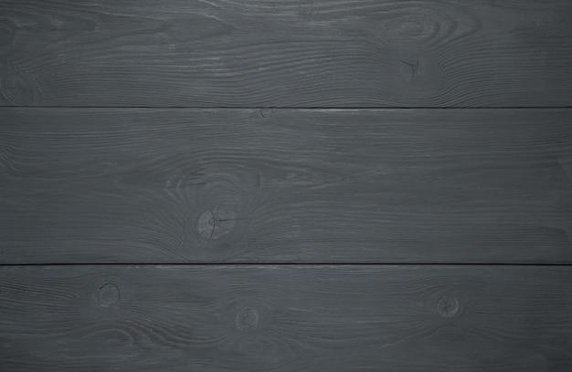 Zwarte houten achtergrond, natuurlijke houtstructuur. de textuur van de boom.