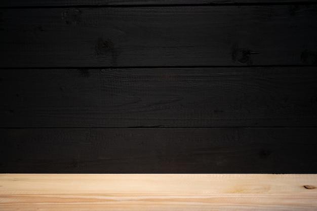 Zwarte houten muur en houten vloer interieur achtergrond of achtergrond achtergrond voor reclame.