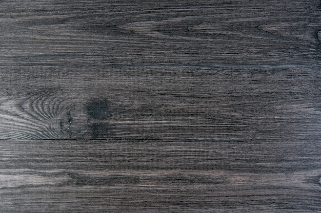 Zwarte houten, oude donkergrijze achtergrond, vintage textuur