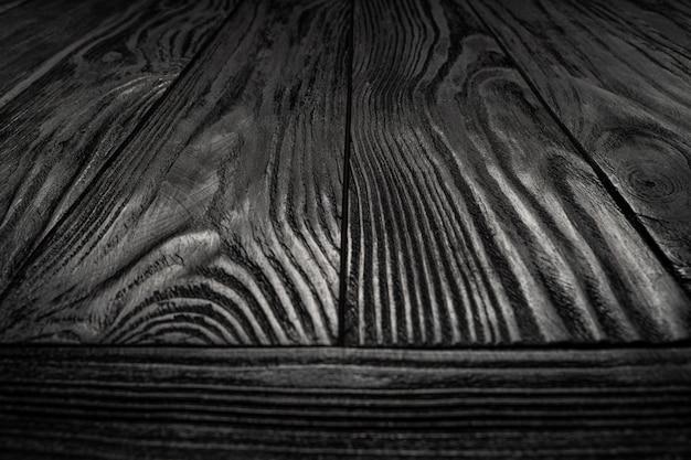 Zwarte houten textuurachtergrond