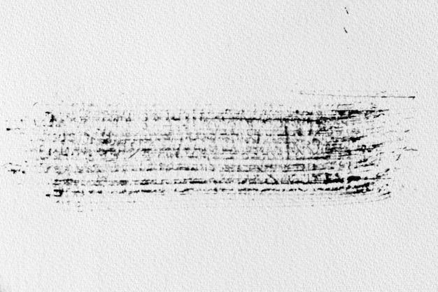 Zwarte inktvorm op aquarelpapiertextuur