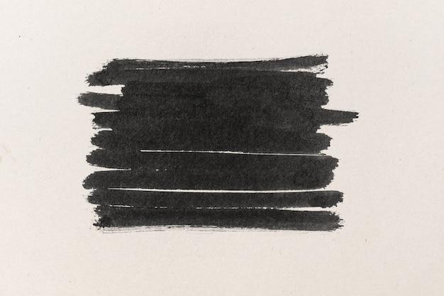Zwarte inktvorm op waterkleurpapier getextureerde achtergrond