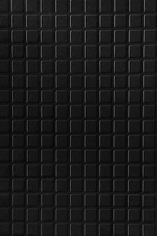 Zwarte keramische tegel baksteen abstracte mozaïek achtergrondstructuur