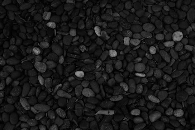 Zwarte kiezelstrand stenen achtergrond