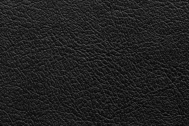 Zwarte lederen textuur achtergrond met naadloos patroon en hoge resolutie.