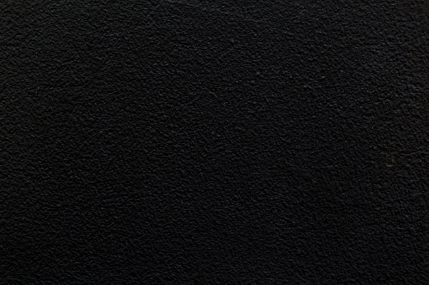 Zwarte lege concrete muur voor achtergrond-beeld.
