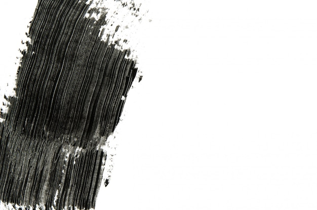 Zwarte mascara penseelstreken achtergrond met copyspace