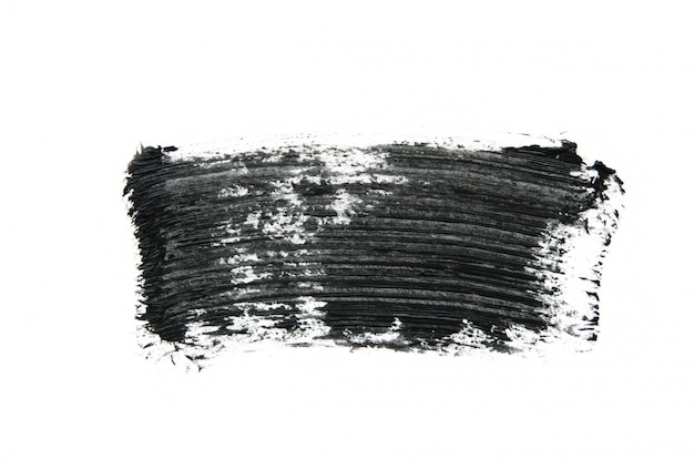 Zwarte mascara penseelstreken geïsoleerd op wit.
