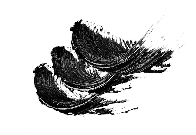 Zwarte mascarapenseelstreken die op wit worden geïsoleerd