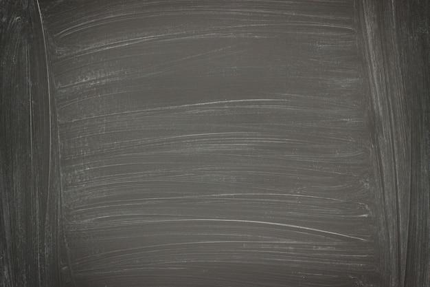 Zwarte muurachtergrond, bordtextuur met krijtresten