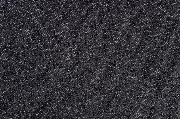 Zwarte niet-geweven stof textuur achtergrond