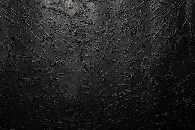 Zwarte of donkergrijze verfrommelde textuurachtergrond