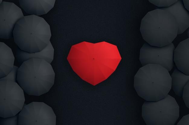 Zwarte parasols scheidden de stromende paraplu in de vorm van een hart