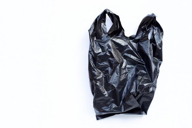 Zwarte plastic zak op een witte achtergrond.