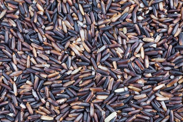 Zwarte rijst bessen achtergrond.