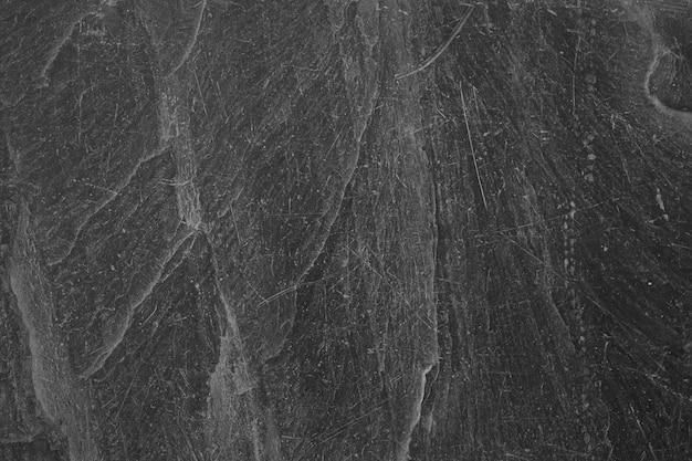 Zwarte steen oppervlakte detail textuur close-up achtergrond