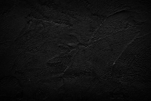 Zwarte stenen muur achtergrond.