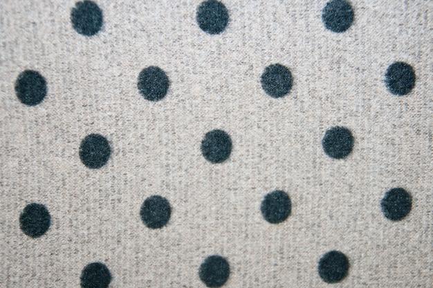 Zwarte stippen en grijze stof textuur achtergrond