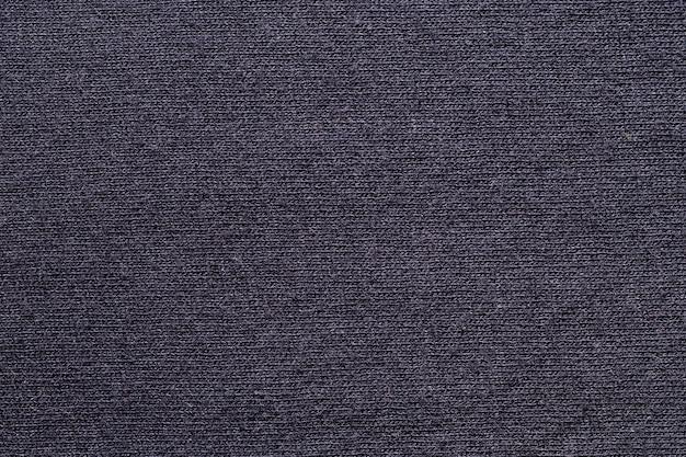 Zwarte stof doek polyester textuur en textiel achtergrond.