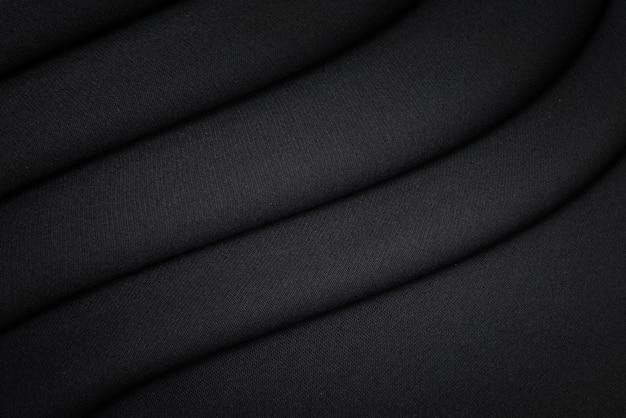 Zwarte stof textuur achtergrond. blanco luxe katoenen textiel en materiaal.