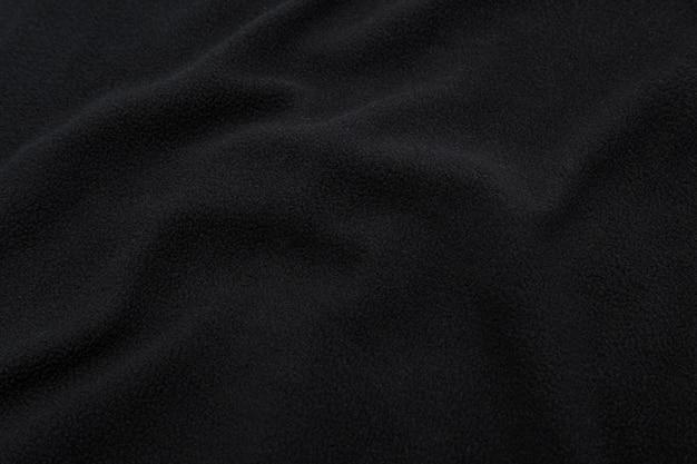 Zwarte stoffentextuur, de achtergrond van het doekpatroon.