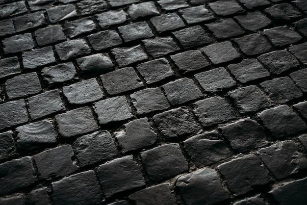 Zwarte textuur van de weg.