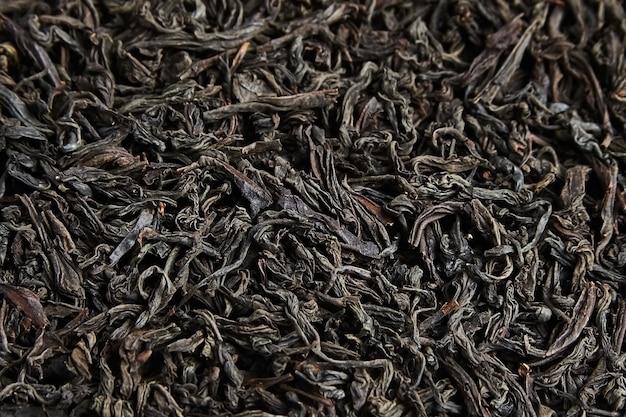 Zwarte thee losse gedroogde bladeren. achtergrond