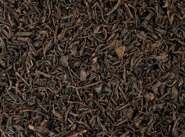 Zwarte theeblaadjes achtergrond close-up weergave van patroon