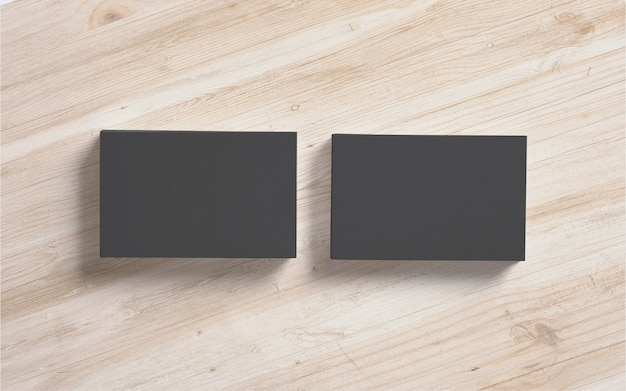 Zwarte visitekaartjesstapels op houten achtergrond. sjabloon om uw presentatie te presenteren.