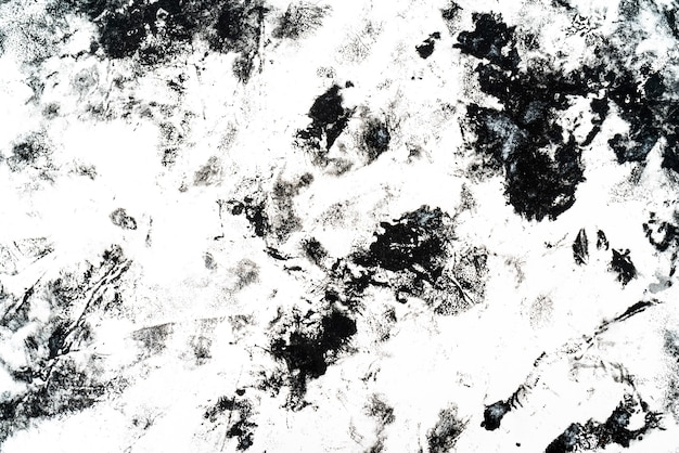 Zwarte vlekken en vlekken op een witte achtergrond.