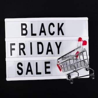 Zwarte vrijdag verkoop lichtbak met winkelwagen