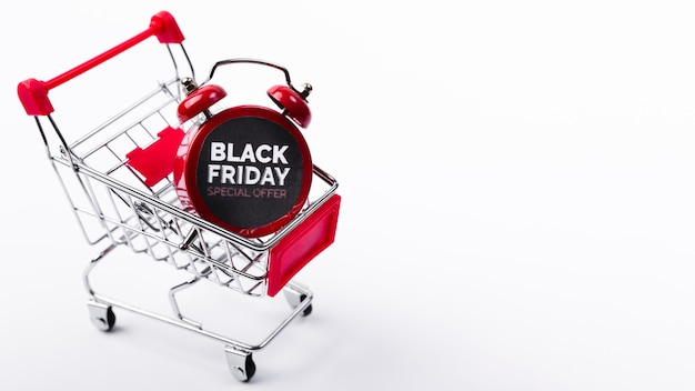 Zwarte vrijdagwekker in winkelwagen