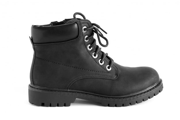 Zwarte zware unisex-laarzen die op wit, schoenen voor de herfstwinterseizoen worden geïsoleerd