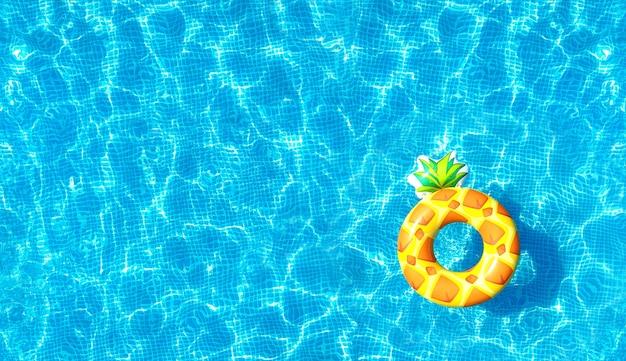 Zwembadwatertextuur met opblaasbaar ananasstuk speelgoed
