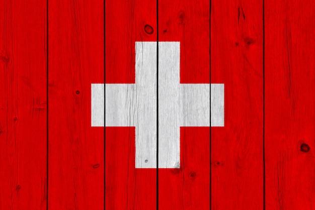 Zwitserland vlag geschilderd op oude houten plank