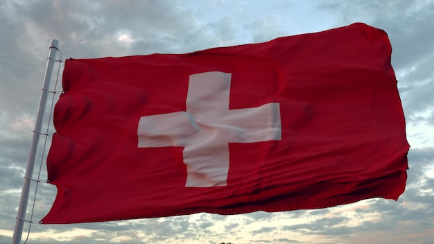 Zwitserse vlag wappert in de wind. nationale vlag van zwitserland