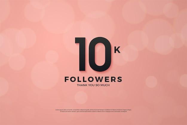 10k volgers of abonnees met zwarte cijfers op een roze achtergrond.