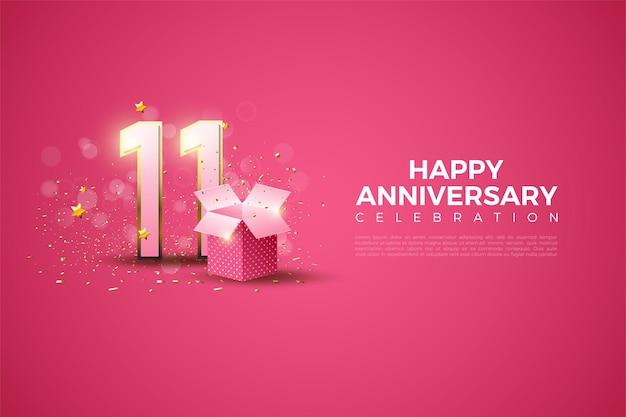 11e verjaardag met een nummerillustratie en een geschenkdoos vooraan.