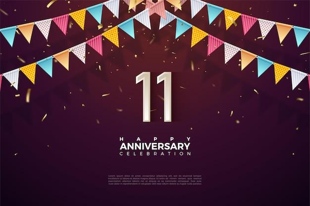 11e verjaardag met numerieke illustratie onder de vlag.
