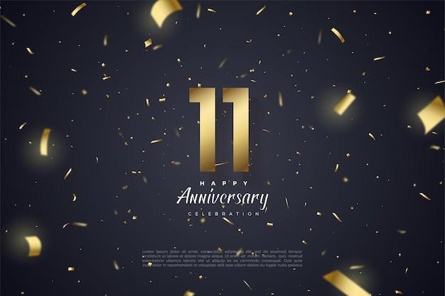 11e verjaardag met nummers bezaaid met goudpapier op zwarte achtergrond.