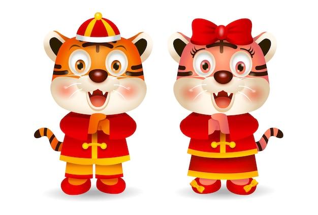 2022 chinees nieuwjaar, leuke cartoontijgers in chinese kostuumgroet. vector