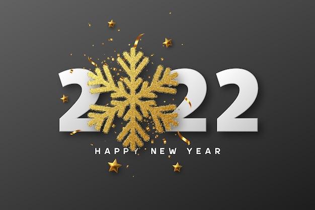 2022 gelukkig nieuwjaar. 3d gouden glitter sneeuwvlok met klatergoud, sterren en witte cijfers op zwart