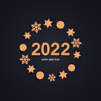 2022 gelukkig nieuwjaar gouden nummers met kerstversiering op de achtergrond